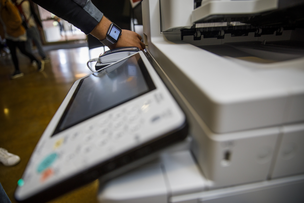 nuAct Card on Apple watch being used at copier